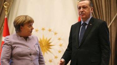 Turkish President Recep Tayyip Erdogan, right, and German Chancellor Angela Merkel.