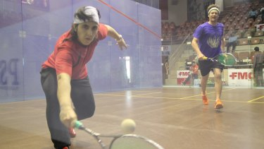 Maria with coach Jonathon Power at the 2014 Asian Squash Championship in Pakistan.