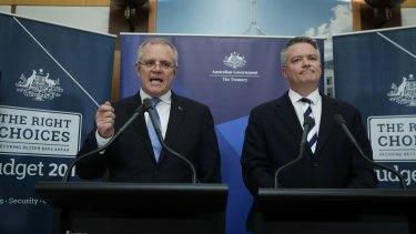 Treasurer Scott Morrison and Finance Minister for Finance Mathias Cormann unveil the mid-year budget update