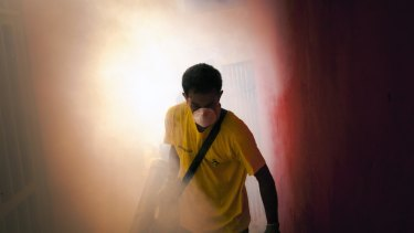 A worker sprays insecticide to eradicate the mosquitoes that carry the Zika virus in the Petare neighbourhood on the outskirts of Caracas, Venezuela.