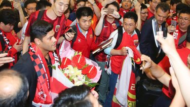 Worth weight in gold: Brazilian forward Hulk is surrounded by fans at the airport in Shanghai in June just before signing with Shanghai SIPG from Zenit St Petersburg for an Asia transfer record $62 million.