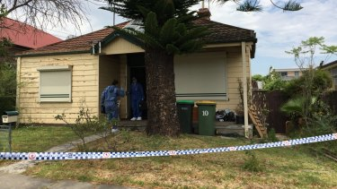 Police search for the body of missing schoolgirl Quanne Diac at a house in Granville on Monday morning.