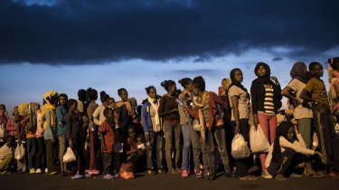 Hundreds of migrants from sub-Saharan Africa arrive at Augusta port in Sicily, Italy.
