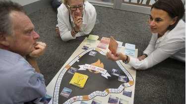 L-R Rowan Mackenzie, Kate Sullivan and Virginia Morris from the Surf Coast Shire play the new fire game.
