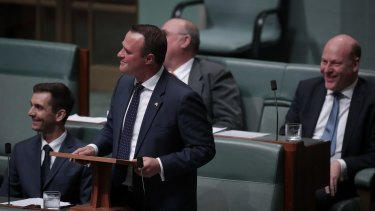 Liberal MP Tim Wilson looks up to the public gallery to ask Ryan Bolger to marry him.