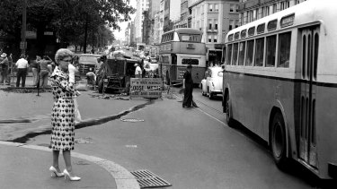 Workmen were constantly employed ripping up Sydney's disused tram tracks and repairing the streets afterwards.
