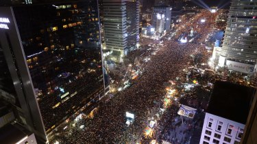 Masses of protesters occupy major streets in the centre of Seoul demanding South Korean President Park Geun-hye's resignation.