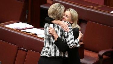 Senator Fiona Nash embraces Senator Michaelia Cash after the Fair Work (Registered Organisations) Amendment Bill 2014 passes the Senate.