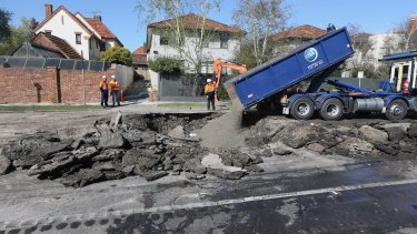 The sinkhole is believed to have been caused by a burst water main.