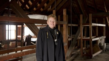 Willard employee Beverly Courtwright and the attic where the suitcases were stored.