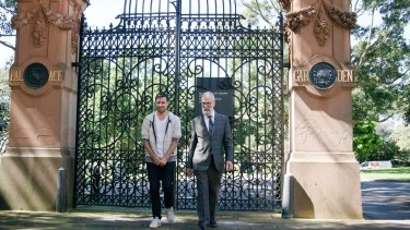 Time portal ... Jonathan Jones and John Kaldor in front of the Garden Palace gates at the Royal Botanic Garden.