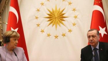 German Chancellor Angela Merkel, left, and Turkish President Recep Tayyip Erdogan in Ankara, Turkey, on Thursday.