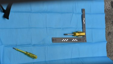 Police also found two screwdrivers n the black bag.