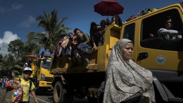 Residents of Marawi who escaped the fighting inside the city endure hours of travel inside overloaded vehicles.