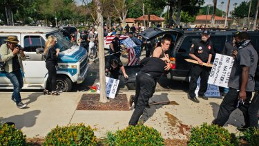 Members of the KKK try to start an anti-immigration rally.