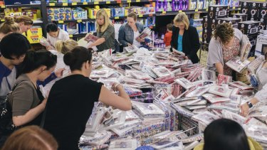 Mothers queued outside Aldi stores on to get their hands on Collette Dinnigan's clothing range for girls.