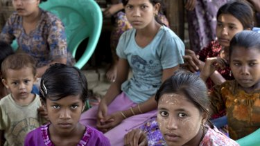 Ethnic Rohingya girls sit at a refugee camp north of Sittwe, western Rakhine state, Myanmar. Muslims from other states who do not identify as Rohingya are also fleeing Myanmar because of persecution.