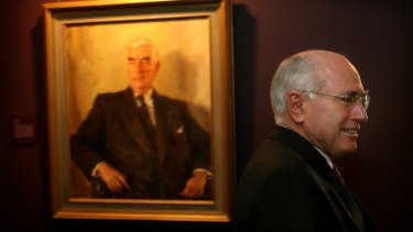 John Howard with a portrait of Menzies at Old Parliament House.