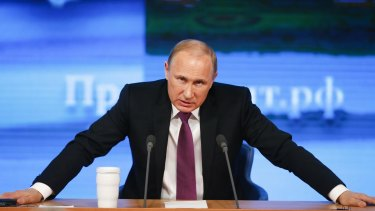 Troubled times: Russian President Vladimir Putin speaks at his annual end-of-year news conference in Moscow.