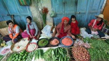 Vendors wait for customers at a local bazaar in Pindaya, southern Shan State, Myanmar.