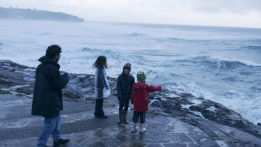 Sydneysiders at Curl Curl emerge to observe the last of the huge ocean swell.
