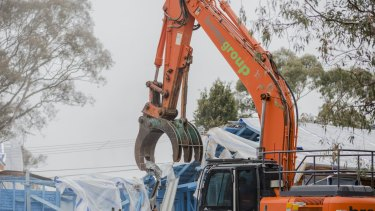 The first Fluffy demolition in Sternberg Crescent, Wanniassa, in June: The Government has now extended the scheme to including adjoining homes.