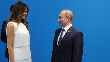Russian President Vladimir Putin greets US President Donald Trump's wife Melania, prior to talks with Trump.