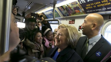 Democratic presidential candidate Hillary Clinton and Bronx Borough president Ruben Diaz jnr ride the subway in the Bronx , New York, on Thursday.