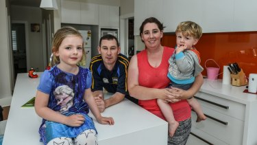 Hollie Adamson with her husband Declan Sheehan and children James and Clodagh in their Concord home. The family does not want to sell, but is being besieged by offers.