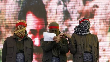 Masked supporters of jailed Kurdish rebel leader Abdullah Ocalan read out the PKK's ceasefire statement at a Newroz (new year) celebration in Diyarbakir, south-east Turkey, in 2013. The recent Turkish air strikes have effectively destroyed the ceasefire.