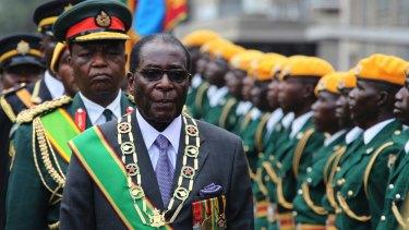 Robert Mugabe inspects a guard of honour.