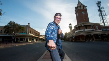 Jean-Claude Van Damme hams it up on the main street of Broken Hill.
