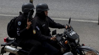 Members of the Venezuelan Bolivarian Intelligence Service during an operation to capture Oscar Perez.
