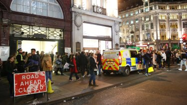 Crowds near the entrance to Oxford Circus tube station.