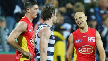 From one star to another: Gary Ablett of the Suns compares notes with Patrick Dangerfield of the Cats after the game.