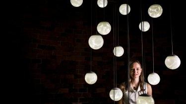 Glass artist Christine Atkins with her work Illumine.