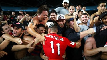 Drought broken: Brendon Santalab joins fans after the final whistle.