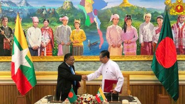 Myanmar's Union Minister Kyaw Tint Swe, right, shakes hands with Bangladeshi Foreign Minister Abdul Hassan Mahmud Ali after signing the deal in Naypyitaw.
