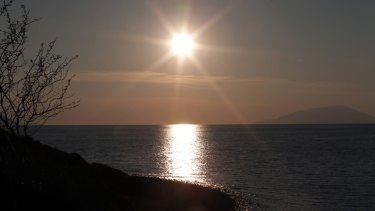 Beauty and terror: The setting sun as seen from the Anzac Cove beach in Gallipoli peninsula.