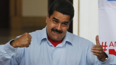 Venezuelan President Nicolas Maduro gestures as he speaks during a march in Caracas, on Thursday.