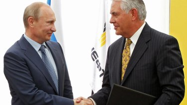 Russian President Vladimir Putin, left, and ExxonMobil chief executive Rex Tillerson, picked for US secretary of state.