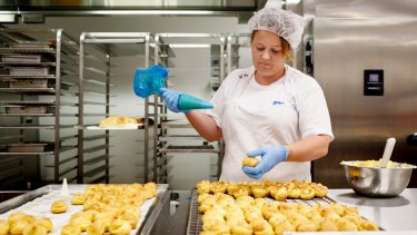 Seven female detainees work six hours shift, five days a week at the new Alexander Maconochie Centre bakery.