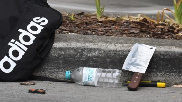 A meat cleaver could be seen in the gutter in the car park where the boy was arrested.