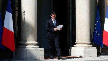 French Prime Minister Manuel Valls arrives to speak to media after a security meeting at the Elysee Palace, in Paris, on Friday.