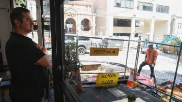 Emanuel Tzirtzilakis says there is no end in sight to  construction outside his Surry Hills cafe.