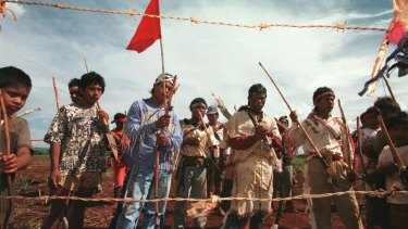 Guarani-Kaiowa people at the gate on their land on the Dourados reservation in 1998.