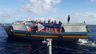 Filipino activists travelled to a tiny settlement in the Spratly Islands in December to protest against China's activities in the South China Sea.