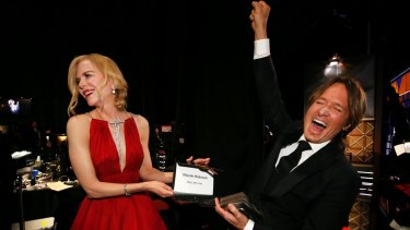 Nicole Kidman, winner of the award for outstanding lead actress in a limited series or a movie for Big Little Lies, and Keith Urban backstage.