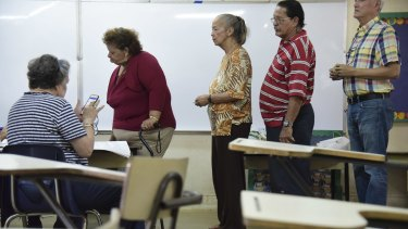 Residents line up to vote during a US election.