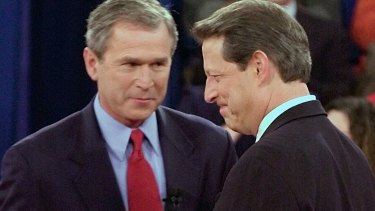 Republican presidential candidate Texas Governor George W. Bush, left, greets Democratic presidential candidate Vice President Al Gore before their debate in 2000.